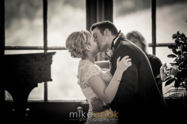 bride and groom kiss, wedding ceremony, dalhousie castle, mike cook photography