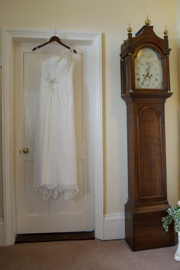 Pengelly Photography, rye far, wedding dress hanging up, grandfather clock