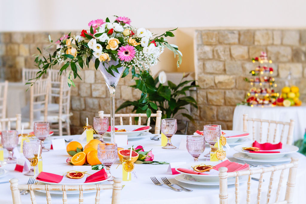 Elizabeth Armitage Photography - colourful wedding tablescape - colourful floral arrangement centrepiece