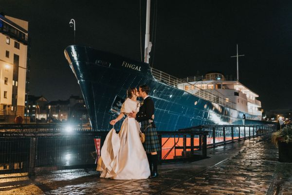 A beautiful Edinburgh Winter Wedding onboard Fingal with pretty red and green details