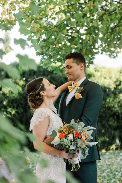 Gorgeous intimate free spirited sustainable wedding inspiration with forest green and earthy tones