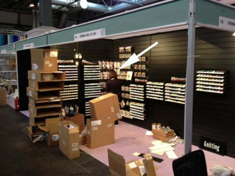 Me (@KreinikGirl) working hard, setting up the Kreinik booth at the Craft Hobby + Stitch International trade show