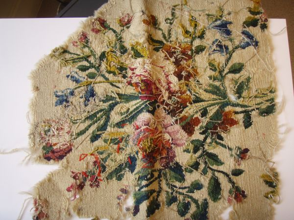 Fragment of 18th century  (?) tapestry showing reverse side. Note the warp threads and the loose threads left during weaving.
