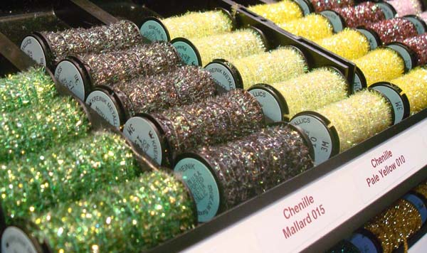 Kreinik Micro-Ice Chenille is a fuzzy thread that you couch on the surface of fabric, needlepoint, embroidery or cross stitch.
