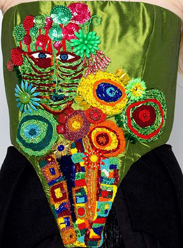 A corset richly embellished with embroidery.