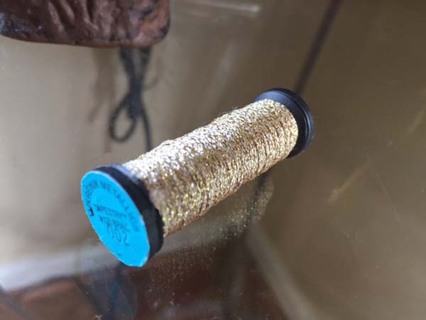 Over the years here at Kreinik, we have seen the most damage done to spools when wrapped with rubber bands. Just say no to rubber bands!