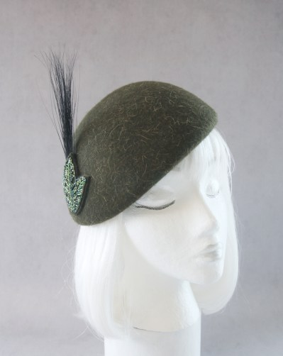 green beaded beret with feather