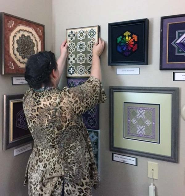 I took this photo of Textured Treasures designer Karen Dudzinski at a recent trade show. It shows a small amount of her wonderful design line. If you are interested in charted/counted needlepoint/canvaswork, look her up.