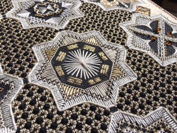 The white Rhodes stitch at the center of this motif is a great stitch to use for flower centers. Look it up online and give it a try using any thread. Design: Dawn to Dusk by Karen Dudzinski