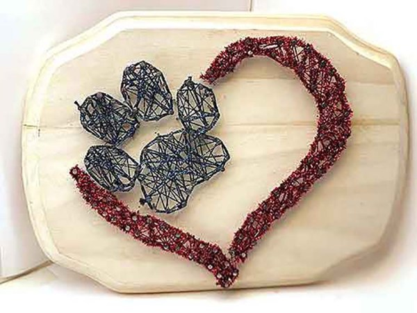 One fun thing about string art: you can make designs that are meaningful to you. Just look up templates for things like paw prints, hearts, the Eiffel Tower, etc. Then star playing with string (ie, yarn, embroidery floss, Kreinik threads, ribbons, etc).