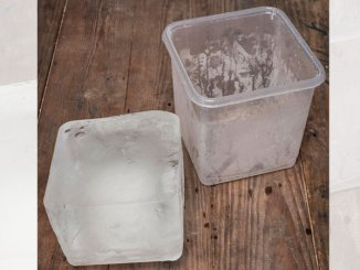 Cheap plastic containers filled with water and placed in your freezer provides free block ice.