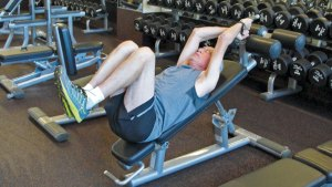 Incline bench abdominal crunches help improve core strength.