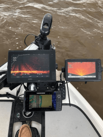 The bow of Hebert's boat looks more like an airplane with the LiveScope down chart (upper left), Perspective Mode (upper right) and Humminbird Helix Sonar (bottom).