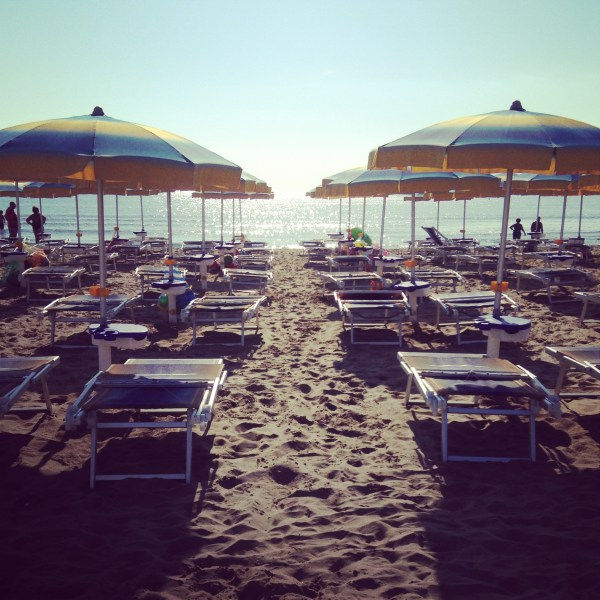 Ombrelloni, umbrellas, at an Italian beach, on Ms. Adventures in Italy by Sara Rosso