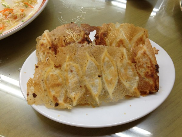 The wings on gyoza, pan-fried dumplings (Chinese) in Japan, by Sara Rosso at Ms. Adventures in Italy