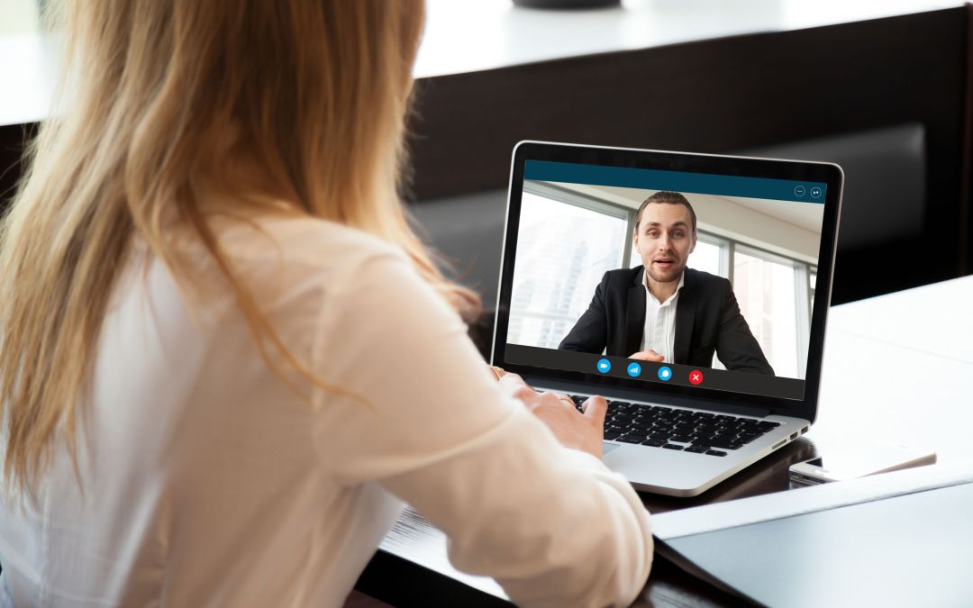 Businesswoman making video call to business partner, webcam chat