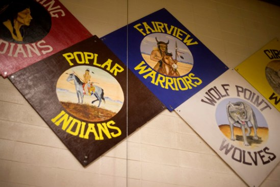 Area school teams mascots and logos hang in the gym of Harlem High School in Harlem, Montana.