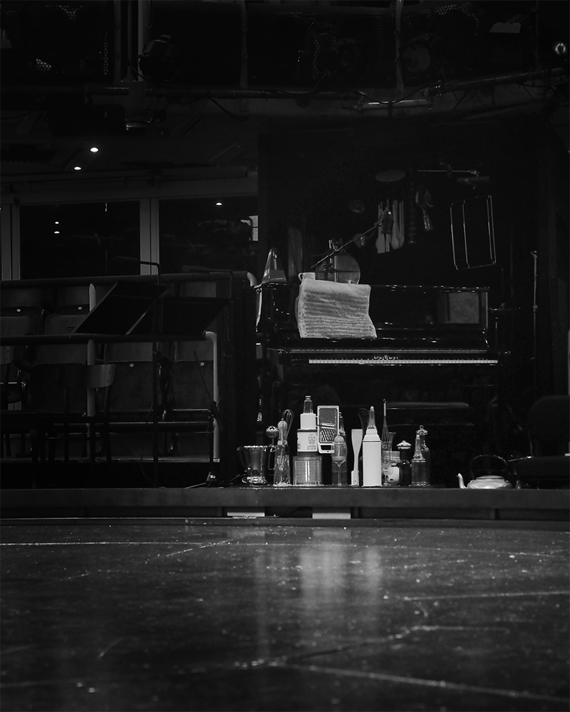 black and white image of objects and a piano