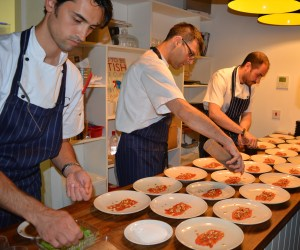Plating up the watermelon carpaccio with hazelnut, aged balsamic and sorrel