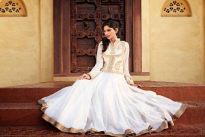 A beautiful white anarkali with gold work