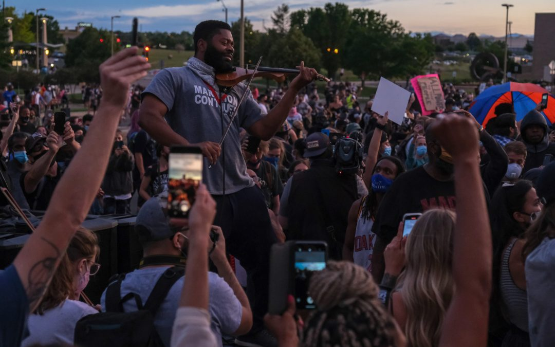 Protesters debate paths to justice for Elijah McClain