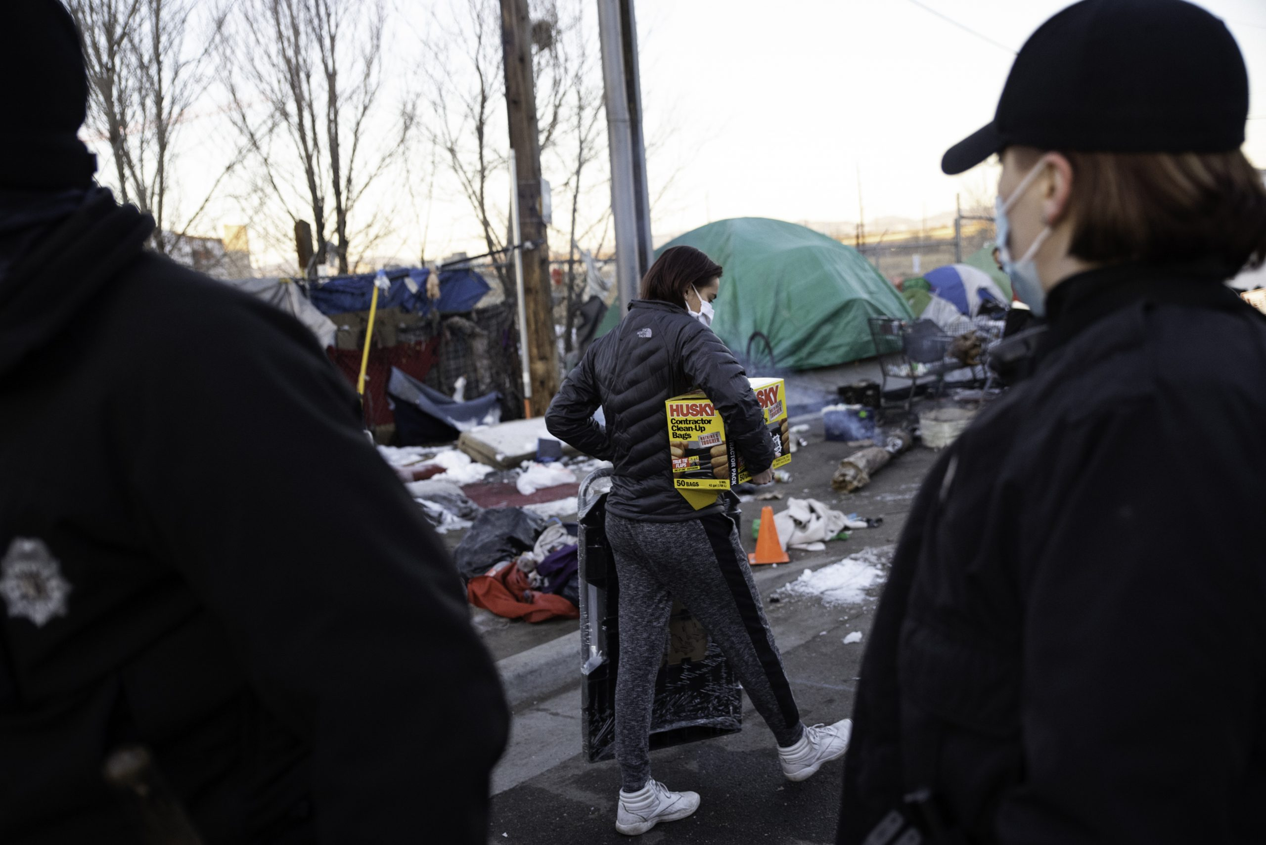 Early morning encampment sweep upends life for more than 100 houseless Denver residents