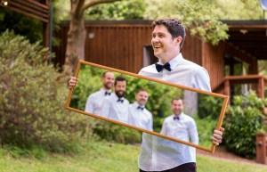 Groom is holding a mirror