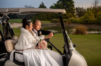 wedding couple in golf cart