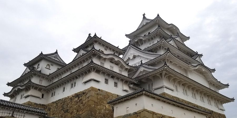 Visiting Himeji Castle from Osaka is super easy when you take the efficient Japan Rail system and follow my Himeji one day itinerary