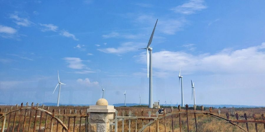 There are several wind turbines between Gaomei Wetlands and Wuqi Fisherman's Harbour.