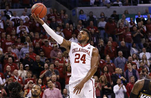 Oklahoma guard Buddy Hield (24) goes up for a basket against VCU in the second half during a second-round men's college basketball game in the NCAA Tournament in Oklahoma City, Sunday, March 20, 2016. Oklahoma won 85-81. (AP Photo/Alonzo Adams)
