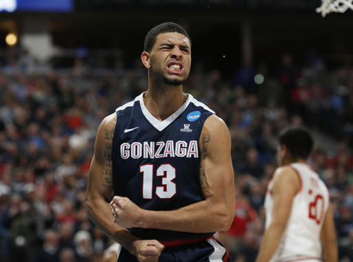 Gonzaga guard Josh Perkins reacts after drawing a foul on a drive to the basket against Utah in the second half of a second-round men's college basketball game Saturday, March 19, 2016, in the NCAA Tournament in Denver. Gonzaga won 82-59. (AP Photo/David Zalubowski)