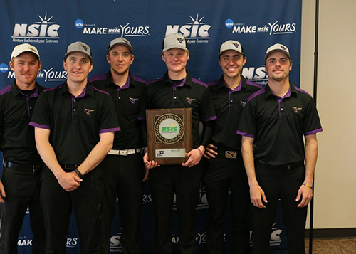 Kelton Schmitz (center) is surrounded by his teammates, after earning Medalist honors. The team earned back-to-back NSIC Championships. (Courtesy of Minnesota State Athletics)