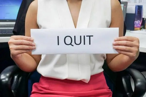 Business woman holding I Quit sign
