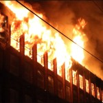 Ladder 1 assists with 4 Alarm Fire