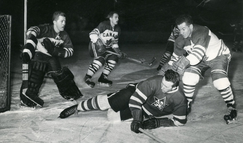 Hockey photograph from 1955 of an amateur championship game between Canada and the Czech Republic.