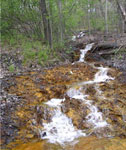 Above: the single worst discharge in the Indian Creek watershed, now being treated