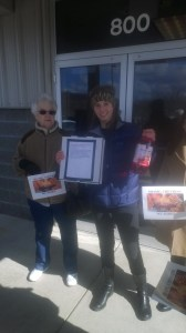 MWA's Community Organizer Kathryn Hilton delivering petitions to Chevron's office.