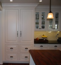 Floor to ceiling cabinet storage with crown moulding ...