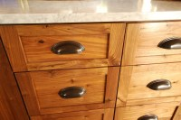 Rustic Walnut cabinets with oil rubbed bronze cup pulls