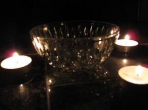 An empty offering bowl in candlelit.