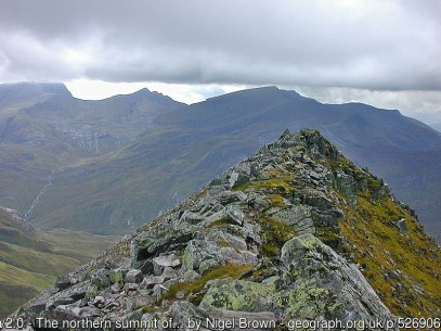 The northern summit of Binnein Mor In the distance are Ben Nevis (in cloud), Carn Mor Dearg and Aonach Beag.