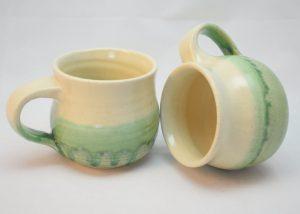 round green and white stoneware mugs