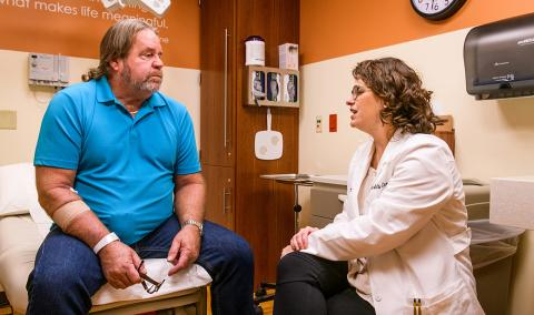 Mark Terry meets with MU Health Care urologist Katie Murray, DO