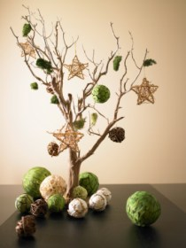 Artwork composed from dried tree branch and paper ornaments