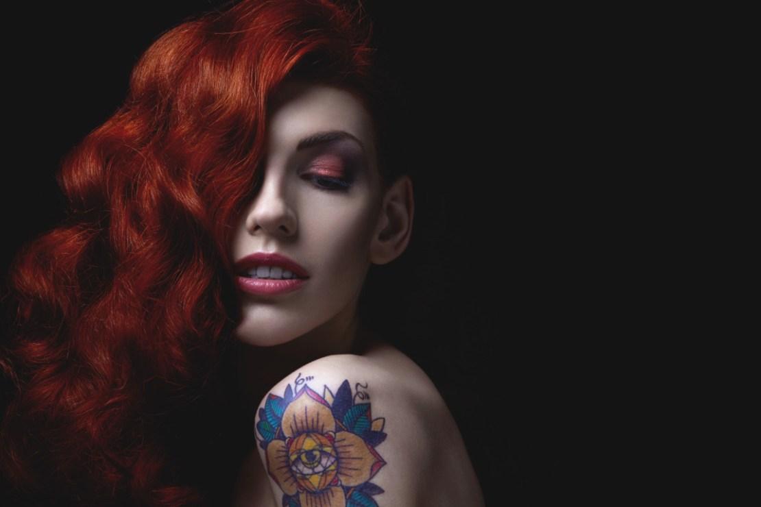 Sensual portrait of beautiful girl with tattoo