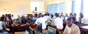 Mukalele Rogers facilitating a staff computer training workshop at Jinja College in 2012