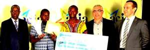 Mukalele Rogers with ICT Minister and Officials from MTN Uganda after the ACIA2013 award gala at Serena Hotel, Kampala