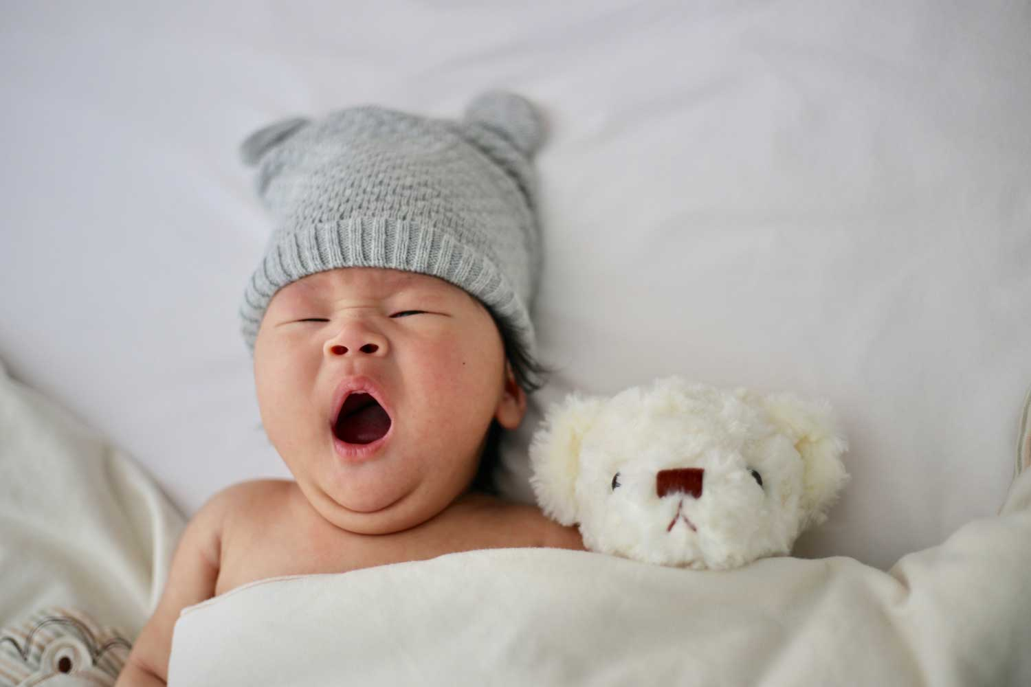 baby yawning and relaxed - baby massage with Anne