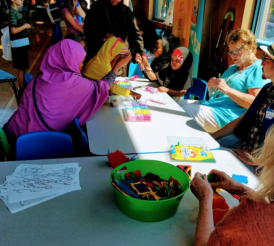 Kids painting at the Community Care Festival